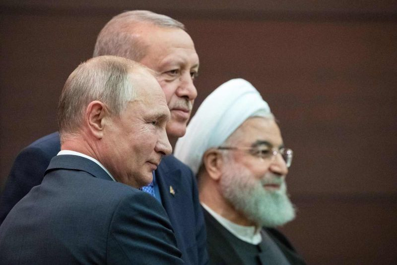 Turkish President Recep Tayyip Erdogan (C), Russian President Vladimir Putin (L) and Iranian President Hassan Rouhani (R) attend a joint press conference in Ankara on Sept. 16, 2019.