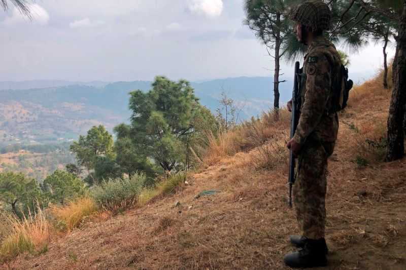 A Pakistan army soldier stands guard on the Line of Control inAbdullah Pur, Pakistani-administered Kashmir on Feb. 5.