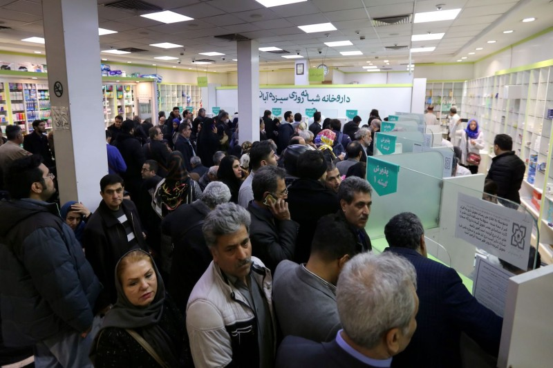 Iranians wait to get prescription drugs in Tehran.