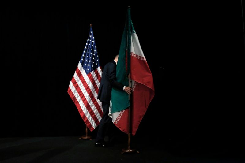 The U.S. and Iranian flags are on stage.