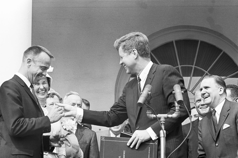 President John F. Kennedy gives astronaut Alan Shepard Jr. a distinguished service medal.
