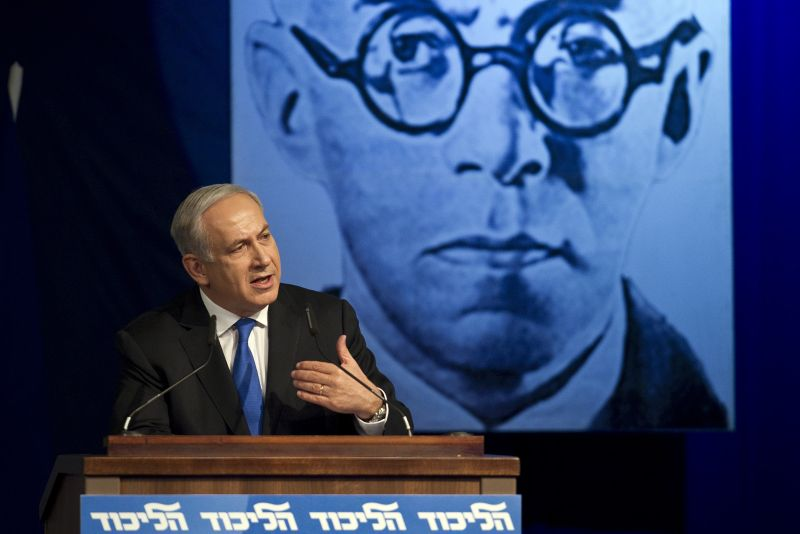 Israeli Prime Minister Benjamin Netanyahu delivers a speech in front of a picture of Zeev Jabotinsky.