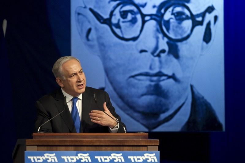 Israeli Prime Minister Benjamin Netanyahu delivers a speech in front of a picture of Zeev Jabotinsky.