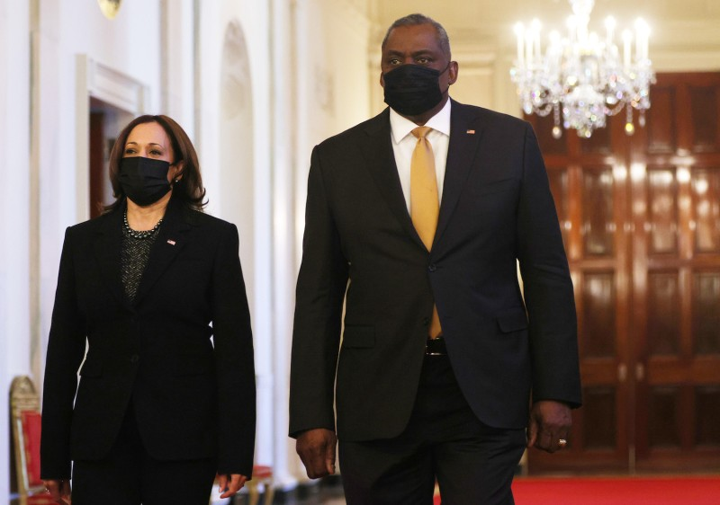 U.S. Secretary of Defense Lloyd Austin and Vice President Kamala Harris enter the East Room of the White House in Washington on March 8.