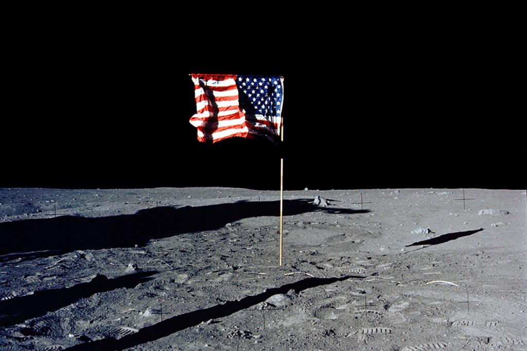 The U.S. flag is planted on the moon's surface.
