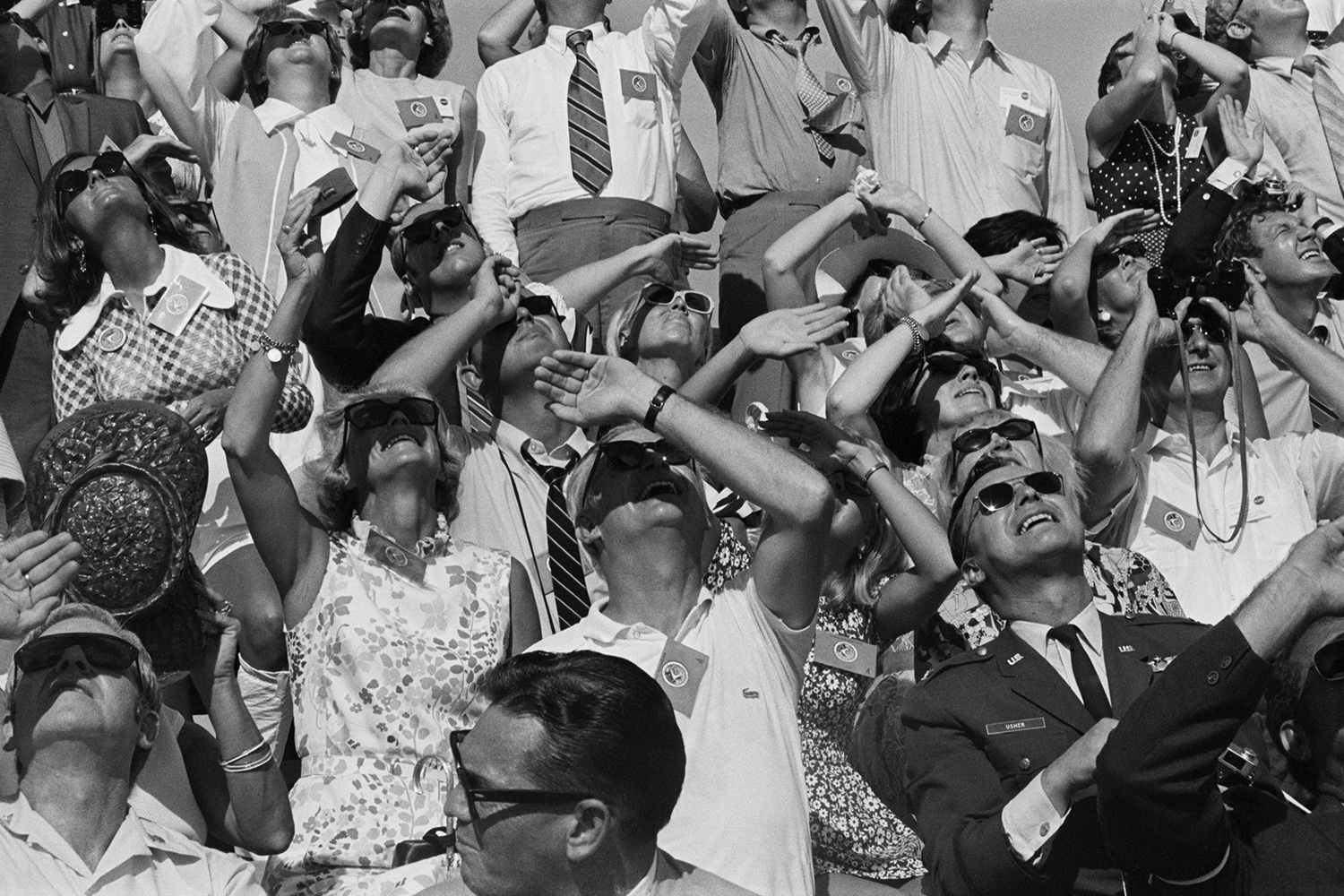 People watch the Apollo 15 rocket launch.