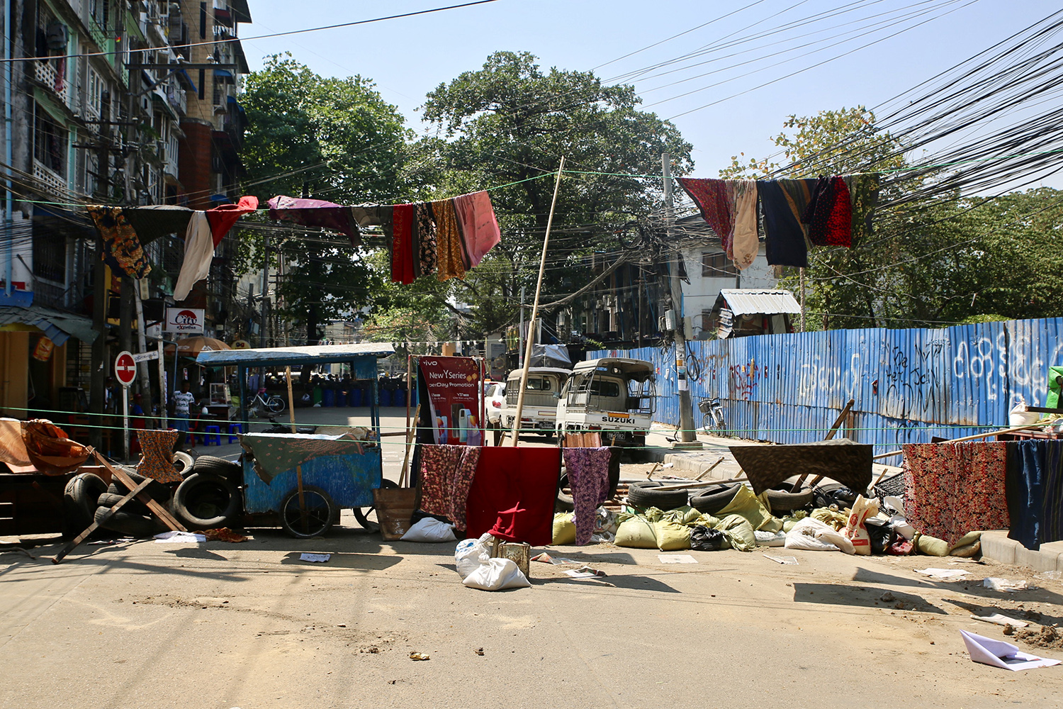 Women's sarongs, known as <em>htamein</em>, hang as one of the first lines of defense upon entering the Myaynigone neighborhood in Yangon, Myanmar, on March 6.