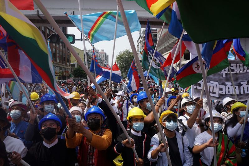 Protesters wave ethnic flags during a demonstration against the military coup in Myanmar.
