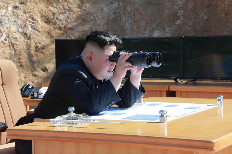 Kim Jong Un watches intercontinental ballistic missile test-fire.