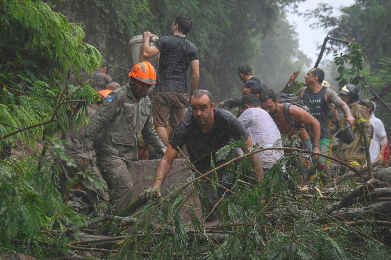 Brazilian rescue workers after a mudslide in Rio de Janeiro.