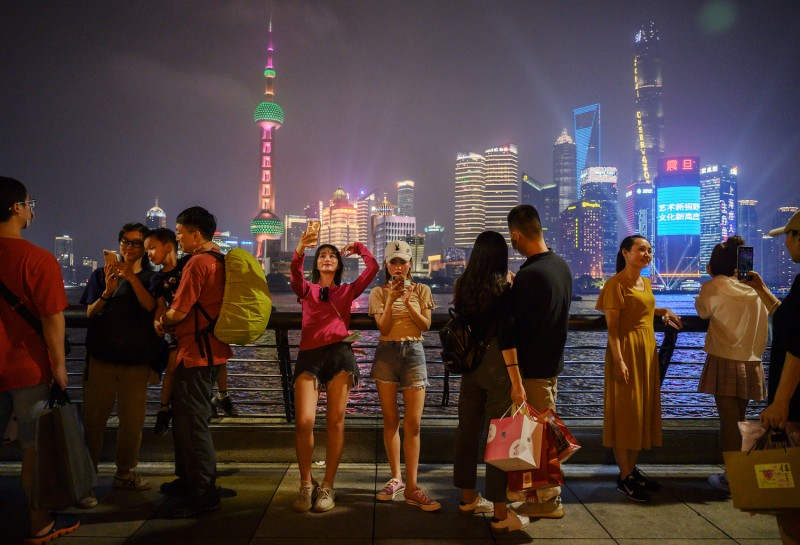 People visit the Bund in Shanghai