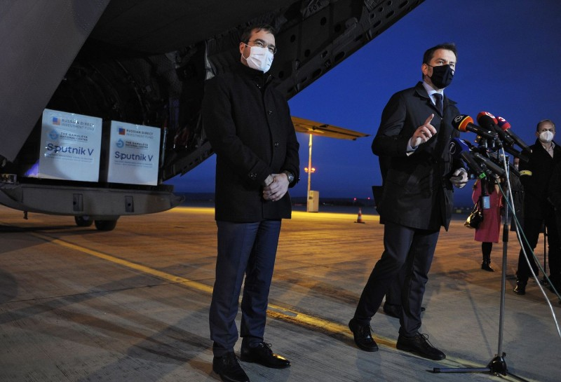 Slovakian Prime Minister Igor Matovic and Health Minister Marek Krajci speak at Kosice International Airport.