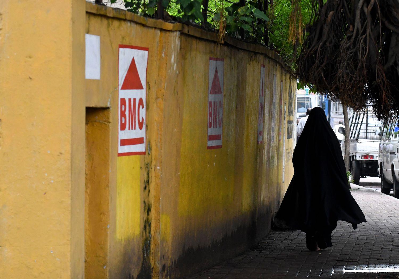 A woman walks along a road in Colombo, Sri Lanka, on April 30, 2019.
