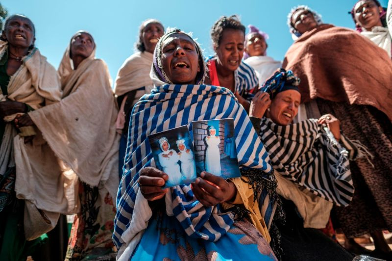 Women mourn the victims of a massacre allegedly perpetrated by Eritrean soldiers in the village of Dengolat, in Ethiopia's Tigray region, on Feb. 26.