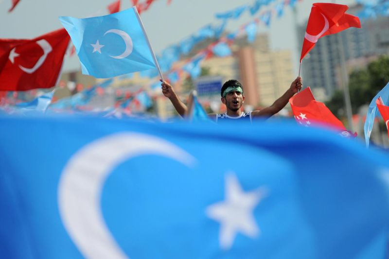Protesters chant slogans and hold up flags in support of China's Uyghur minority in Istanbul, Turkey, on July 12, 2009.