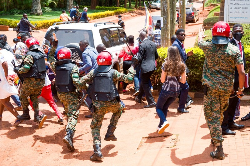 Supporters of Ugandan opposition leader Robert Kyagulanyi, also known as Bobi Wine, and local and foreign journalists are assaulted by Uganda Military Police outside the U.N. Human Rights Offices in Kampala on Feb. 17.