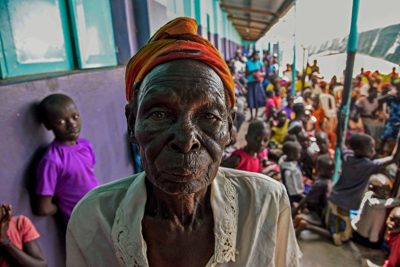 A Ugandan woman poses before watching the opening of Dominic Ongwen's ICC trial.