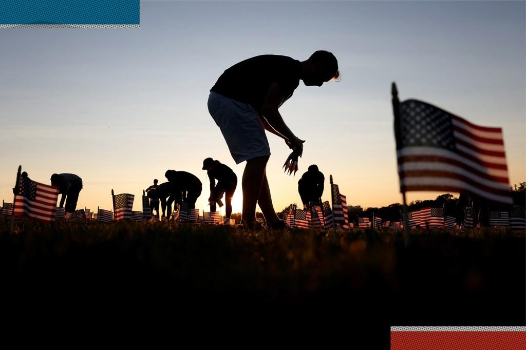 Volunteers install U.S. flags in Washington.