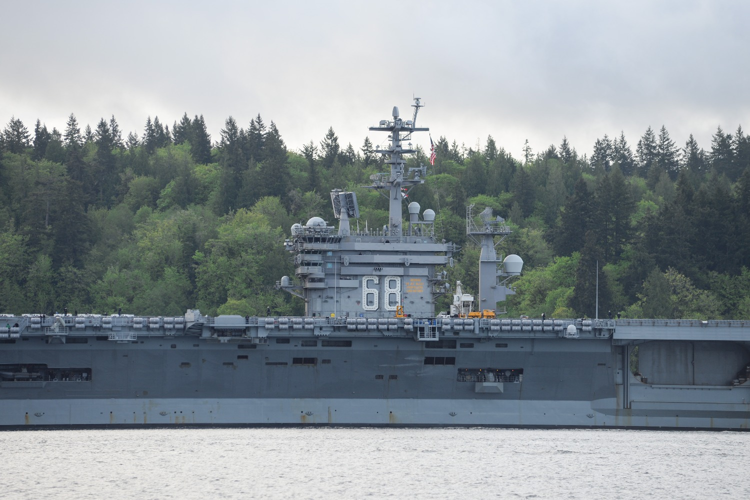 The USS Nimitz gets underway through Sinclair Inlet from Naval Base Kitsap in Bremerton, WA, on Apr. 27, 2020.
