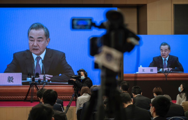 Chinese Foreign Minister Wang Yi answers questions.