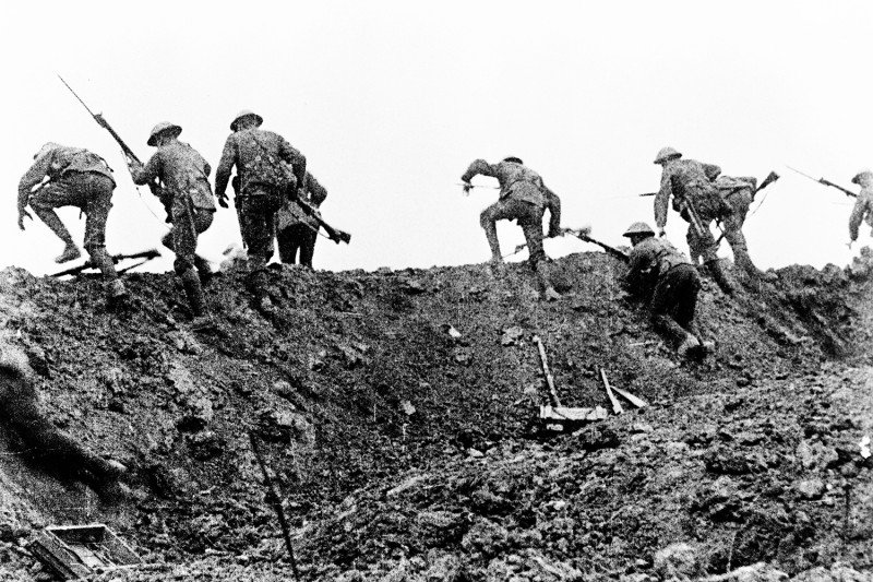 "A still from the documentary film The Battle of the Somme purportedly shows British soldiers moving forward through wire at the start of the battle on July 1, 1916. This scene is now generally considered to have been staged well behind the lines but has regularly been used to represent British troops ""going over the top"" at the start of an assault on the Western Front."