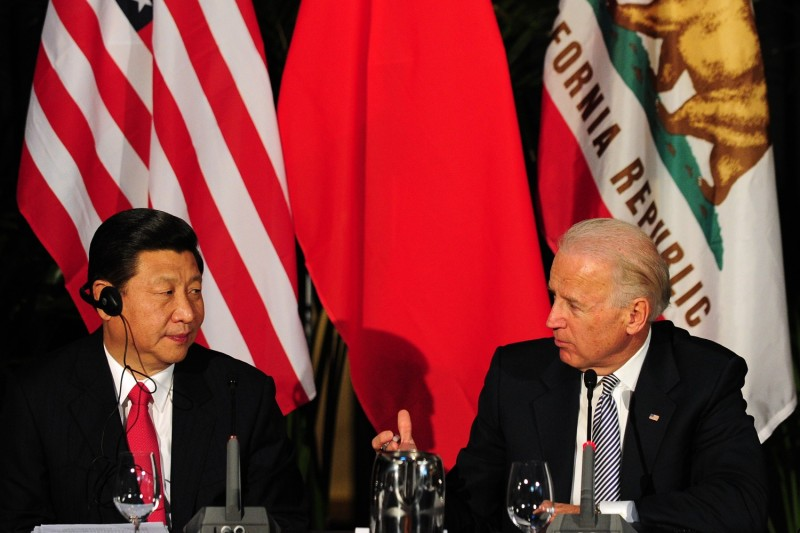 Biden and Xi attend a meeting in 2012.