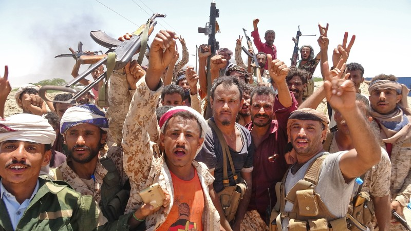 Yemeni fighters gesture following clashes with Saudi-backed government forces near the village of Shaykh Salim in southern Yemen on May 11, 2020.