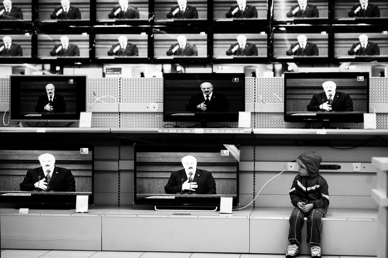 A boy sits close to TV sets at a shop in Minsk on April 29, 2015, during a broadcast of Belarus' President Alexander Lukashenko's annual state of the nation address. AFP PHOTO / SERGEI GAPON        (Photo credit should read SERGEI GAPON/AFP via Getty Images)
