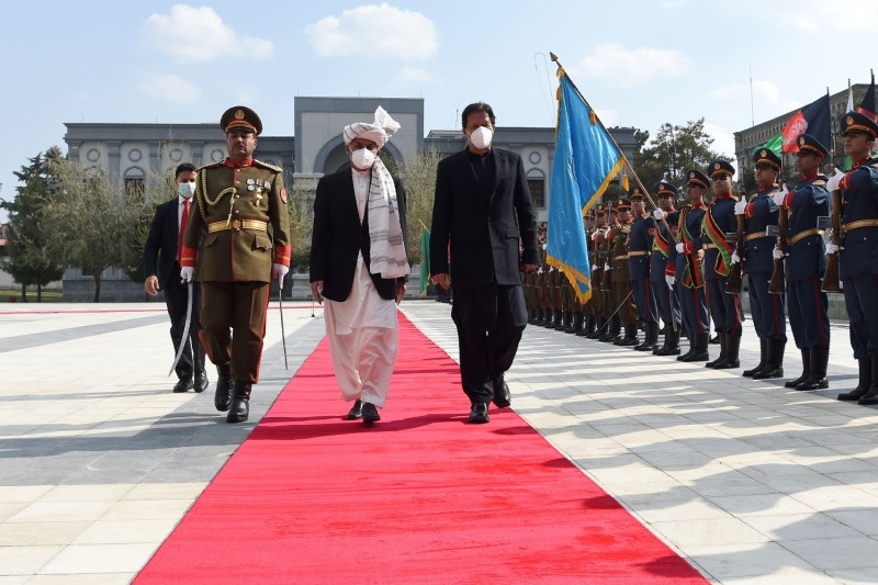 Pakistan's Prime Minister Imran Khan and Afghan President Ashraf Ghani inspect a guard of honor.