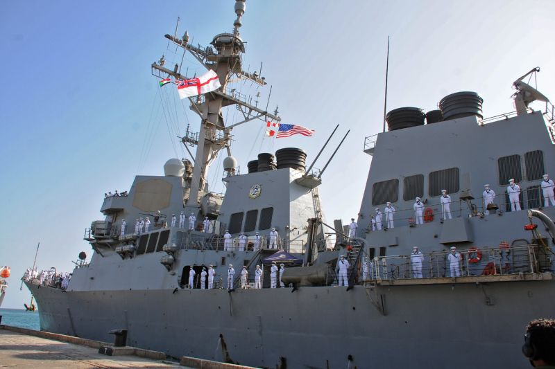 U.S. sailors look on as they stand aboard the U.S. Navy guided-missile destroyer USS Winston S. Churchill while it anchors in Port Sudan on March 1.