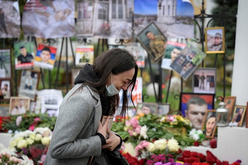 A woman cries at a makeshift memorial for Armenians killed during the military conflict with Azerbaijan.