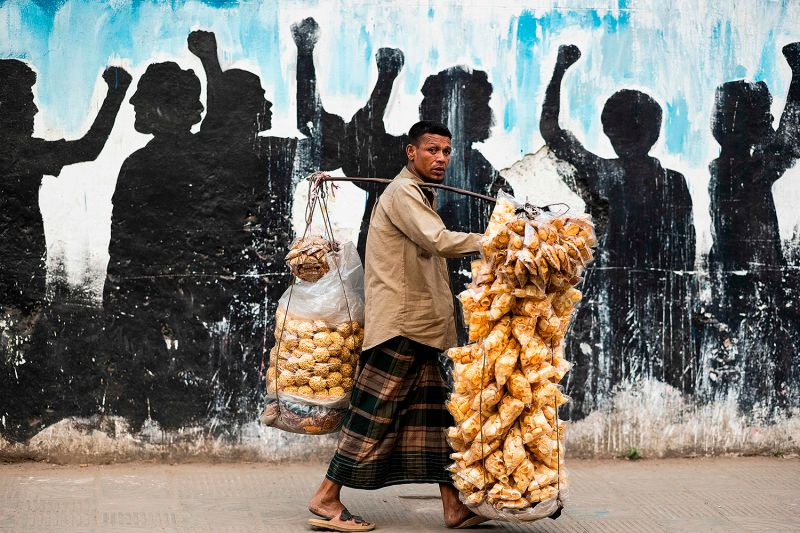 A snack vendor in Dhaka, Bangladesh
