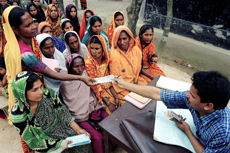 Women use microcredit in Dhaka, Bangladesh, on March 1, 1998.