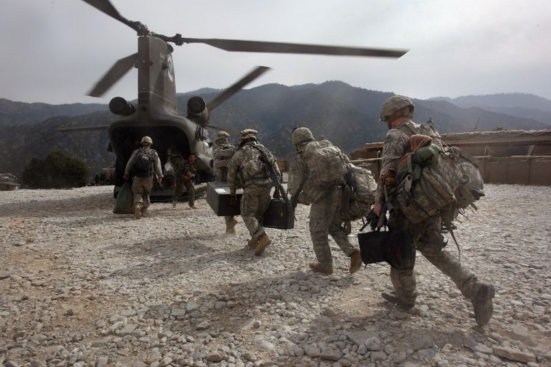 U.S. soldiers board a helicopter in Korengal Valley.