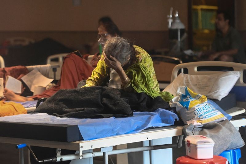 A patient rests inside a banquet hall temporarily converted into a COVID-19 ward in New Delhi on April 27.