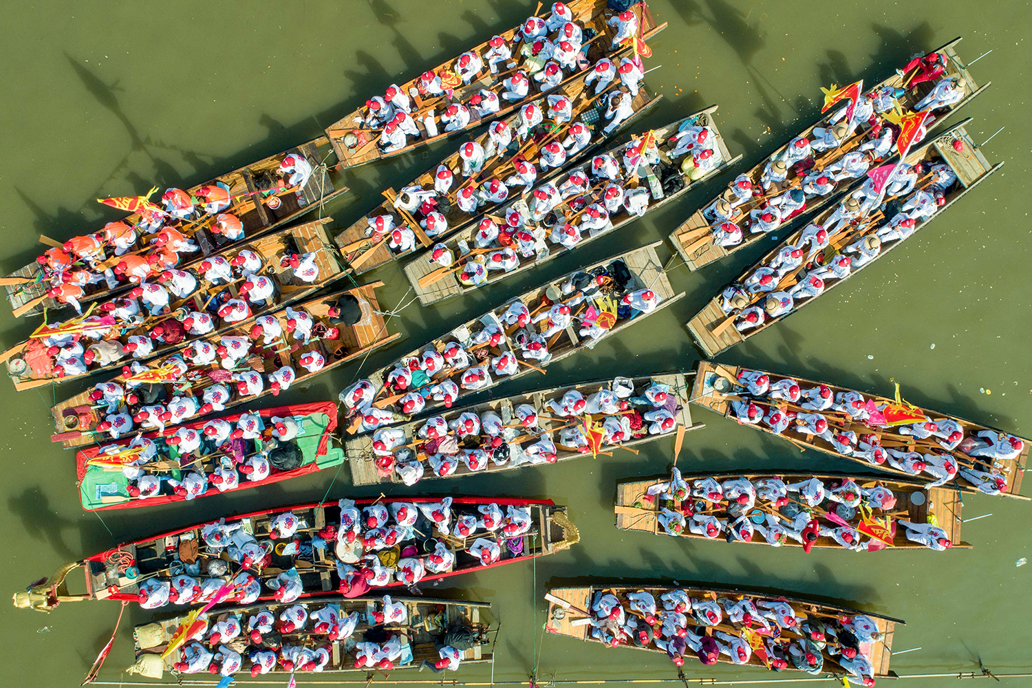 Boats prepare to take part in a performance during the Qintong Boat Festival in Taizhou, China, on April 8. STR/AFP via Getty Images