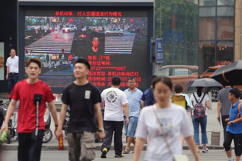 Pedestrians walk in China.