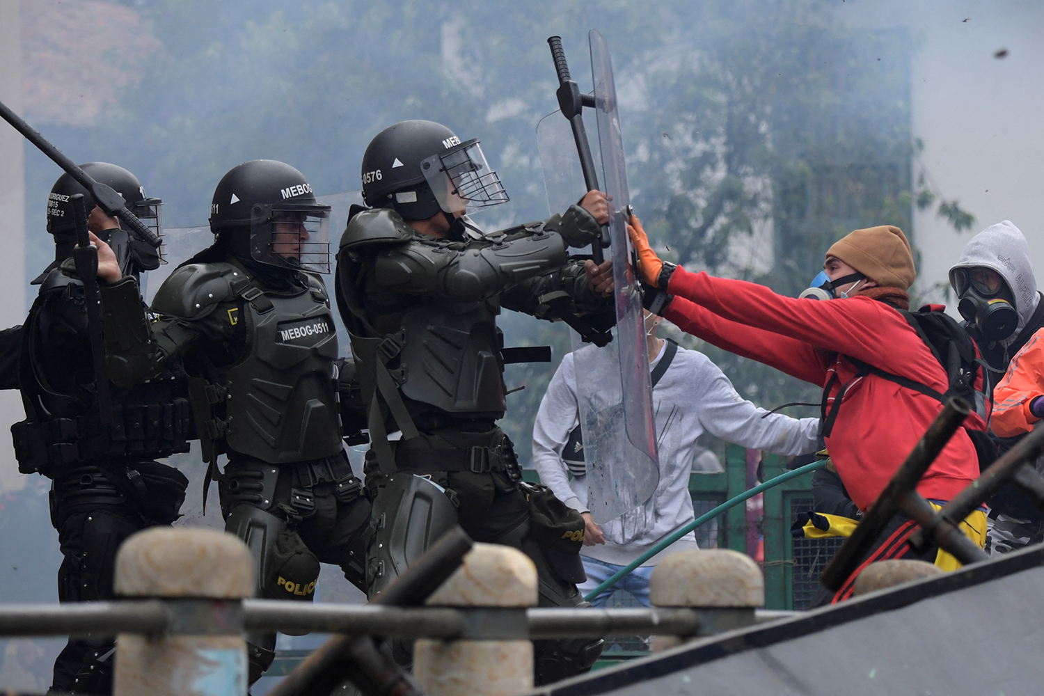 Demonstrators clash with police during a protest against tax reform in Bogota, Colombia, on April 28. RAUL ARBOLEDA/AFP via Getty Images