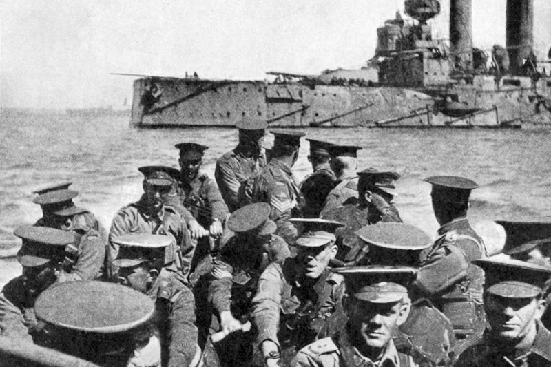 Australian infantrymen sit on a transport as they head toward the beach at Gallipoli, Turkey, in 1915.