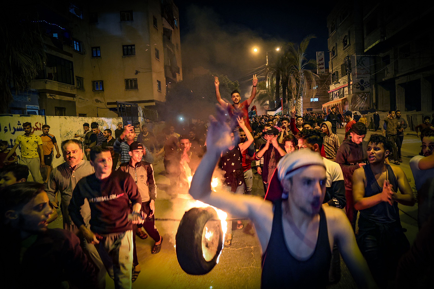Palestinians parade a burning tire through the streets of Gaza City on April 24 as they shout slogans in support of the Al-Aqsa Mosque and condemn overnight clashes in the Israeli-annexed east Jerusalem. MOHAMMED ABED/AFP via Getty Images