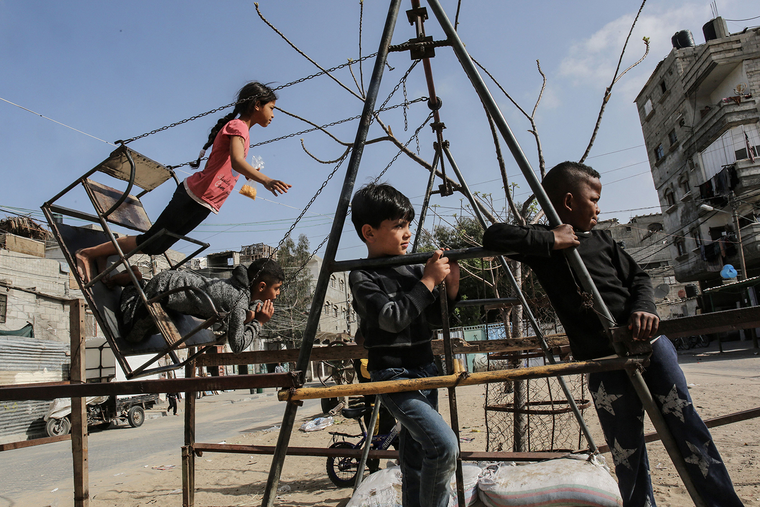 Palestinian children play at the Rafah refugee camp in the southern Gaza Strip on April 8. SAID KHATIB/AFP via Getty Images