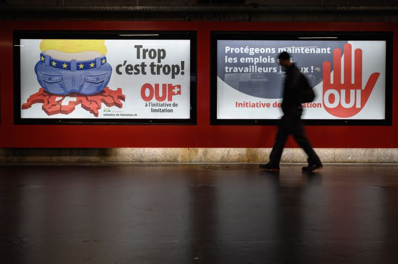 """Electoral posters in Lausanne, Switzerland that translate from French as """"Too much is too much!"""" and """"Protecting the jobs of local workers now"""" to advertise a right-wing Swiss Peoples Party (SVP)-backed initiative that voted on Sept. 27, 2020 demanding that the government scrap the freedom of movement agreement with the EU within a year."""