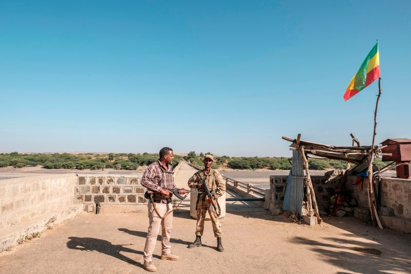 A member of the Amhara special forces and a member of the Amhara militia stand at Ethiopia's border crossing with Eritrea in Humera, Ethiopia, on Nov. 22, 2020.