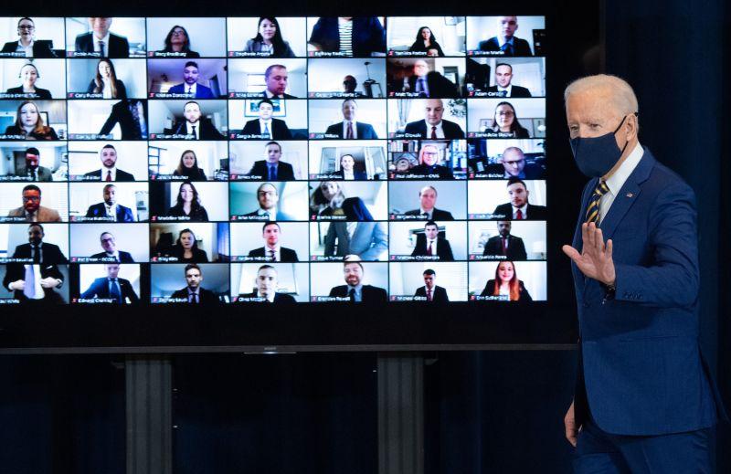 U.S. President Joe Biden leaves after speaking to U.S. State Department staff.