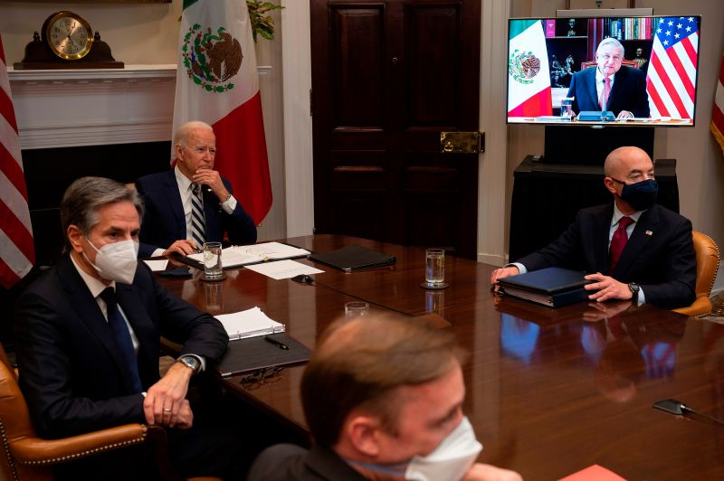Joe Biden, flanked by Secretary of State Antony Blinken and Secretary of Homeland Security Alejandro Mayorkas (R), meets virtually with Mexican  President Andres Manuel Lopez Obrador at the White House in Washington on March 1, 2021.