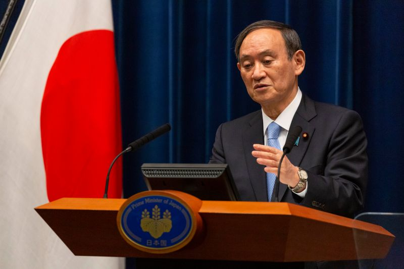 Japanese Prime Minister Yoshihide Suga speaks during a press conference.