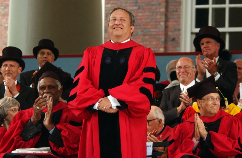 Larry Summers receives applause from Microsoft co-founder and Chairman Bill Gates during commencement ceremonies at Harvard University on June 7, 2007.