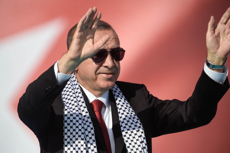 Recep Tayyip Erdogan salutes his supporters during a rally at Istanbul's Yenikapi fairground to show solidarity with Palestinians after Israels aggression against Palestinian civilians on the Gaza border in Istanbul on May 18, 2018.