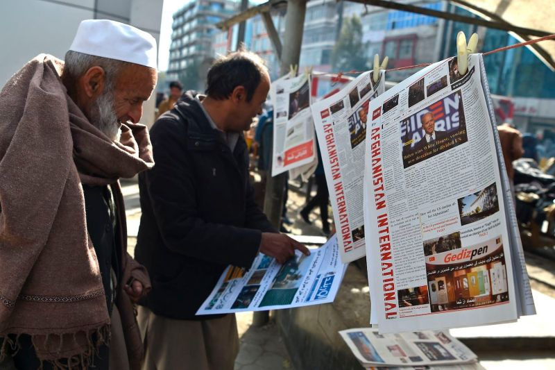 A man reads a local newspaper showing a photograph of U.S. President-elect Joe Biden, in Kabul on Nov. 8, 2020.