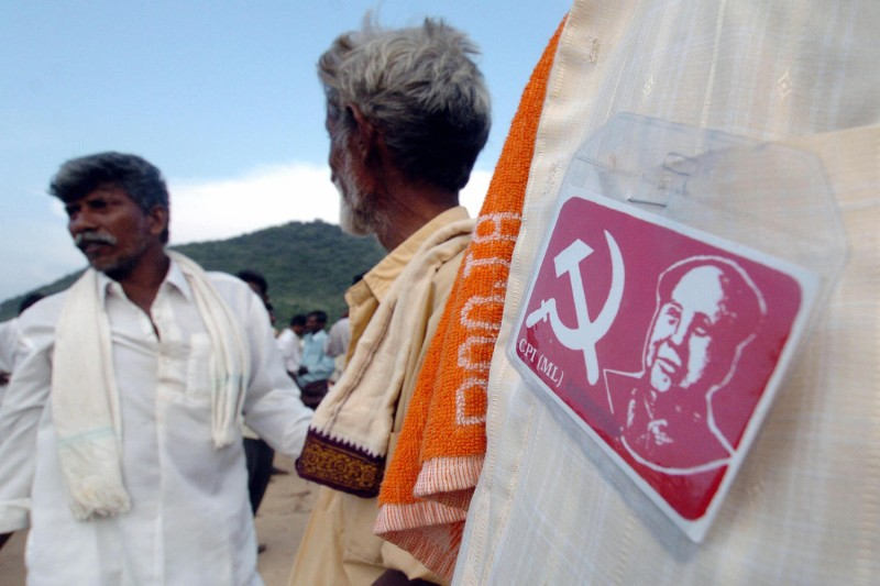 Supporters of Naxalite People's War Group wait for leaders to address a public meeting in India's Guntur district on Oct. 11, 2004.